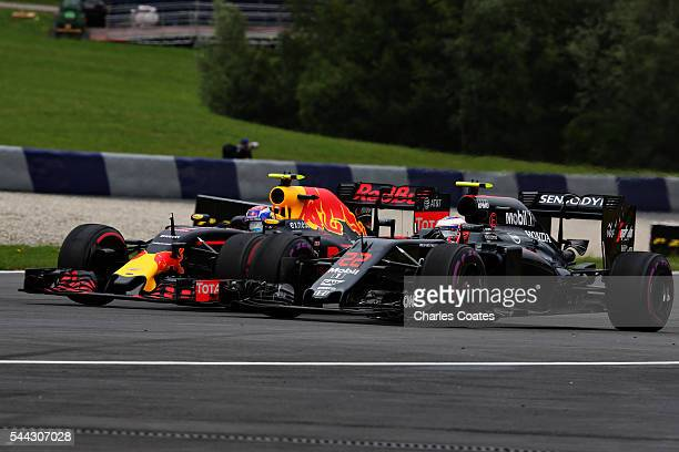 Max Verstappen of the Netherlands driving the Red Bull Racing Red BullTAG Heuer RB12 TAG Heuer and Jenson Button of Great Britain driving the McLaren...