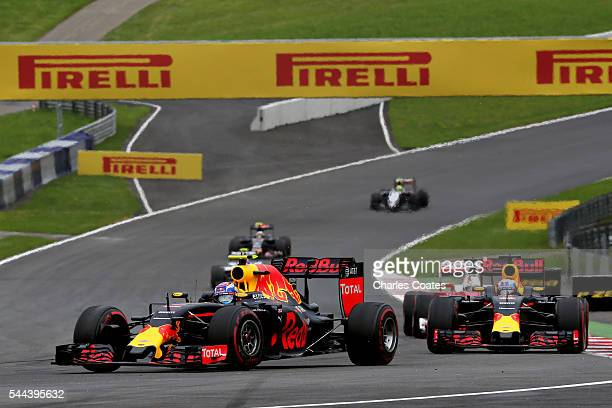 Max Verstappen of the Netherlands driving the Red Bull Racing Red BullTAG Heuer RB12 TAG Heuer leads Daniel Ricciardo of Australia driving the Red...
