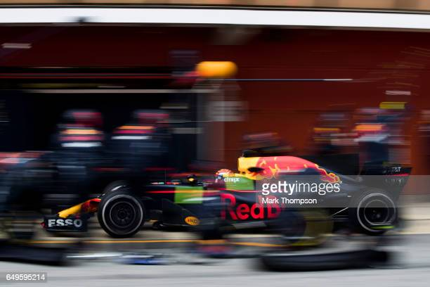 Max Verstappen of the Netherlands driving the Red Bull Racing Red BullTAG Heuer RB13 TAG Heuer makes a pit stop for new tyres during day two of...