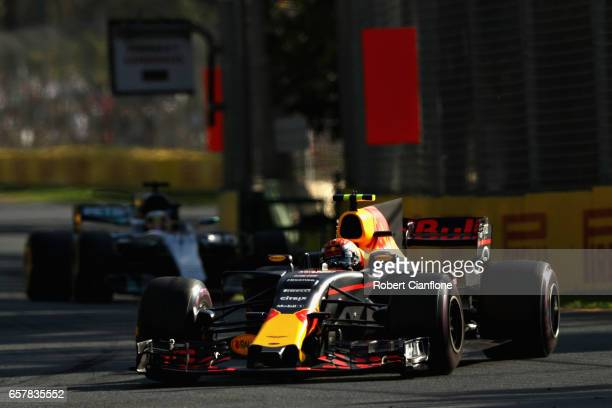 Max Verstappen of the Netherlands driving the Red Bull Racing Red BullTAG Heuer RB13 TAG Heuer leads Lewis Hamilton of Great Britain driving the...