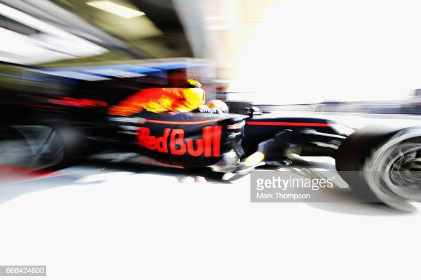 Max Verstappen of the Netherlands driving the Red Bull Racing Red BullTAG Heuer RB13 TAG Heuer leaves the garage during practice for the Bahrain...