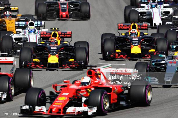 Max Verstappen of the Netherlands driving the Red Bull Racing Red BullTAG Heuer RB13 TAG Heuer and Daniel Ricciardo of Australia driving the Red Bull...