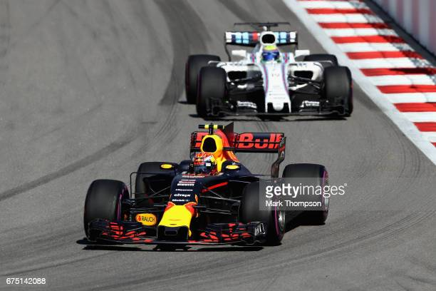 Max Verstappen of the Netherlands driving the Red Bull Racing Red BullTAG Heuer RB13 TAG Heuer leads Felipe Massa of Brazil driving the Williams...