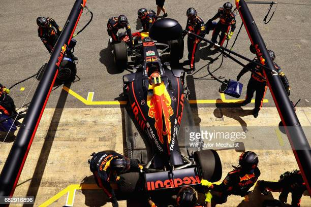 Max Verstappen of the Netherlands driving the Red Bull Racing Red BullTAG Heuer RB13 TAG Heuer is pushed back into the garage after retiring during...