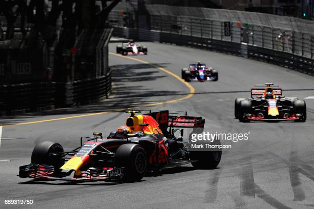 Max Verstappen of the Netherlands driving the Red Bull Racing Red BullTAG Heuer RB13 TAG Heuer leads Daniel Ricciardo of Australia driving the Red...