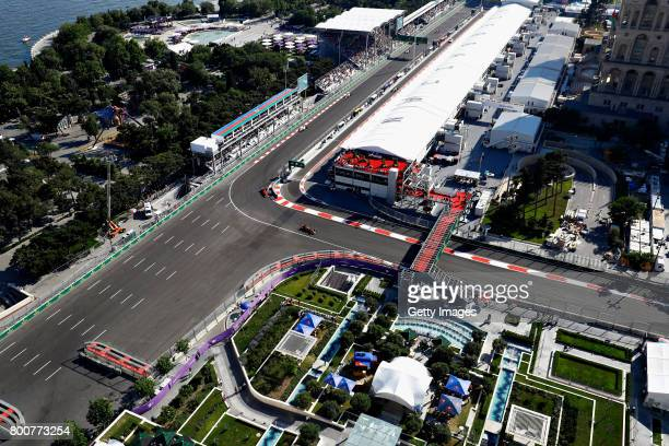 Max Verstappen of the Netherlands driving the Red Bull Racing Red BullTAG Heuer RB13 TAG Heuer leads Kimi Raikkonen of Finland driving the Scuderia...
