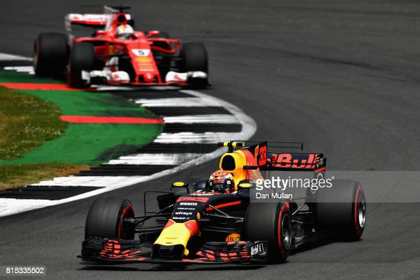 Max Verstappen of the Netherlands driving the Red Bull Racing Red BullTAG Heuer RB13 TAG Heuer leads Sebastian Vettel of Germany driving the Scuderia...