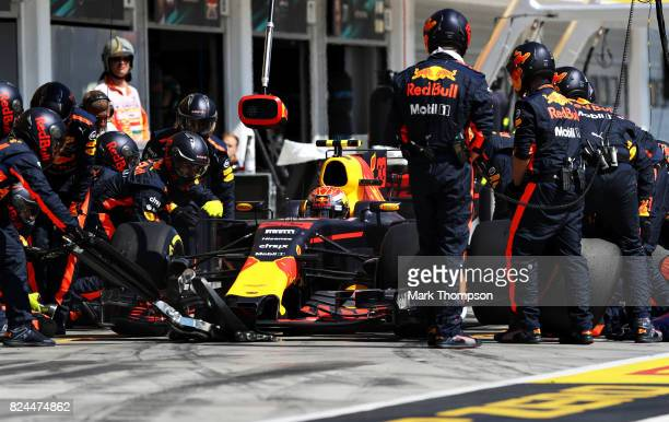 Max Verstappen of the Netherlands driving the Red Bull Racing Red BullTAG Heuer RB13 TAG Heuer makes a pit stop for new tyres during the Formula One...