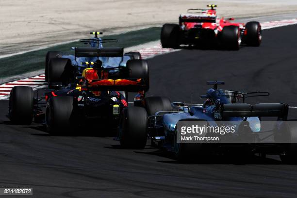 Max Verstappen of the Netherlands driving the Red Bull Racing Red BullTAG Heuer RB13 TAG Heuer follows Valtteri Bottas driving the Mercedes AMG...