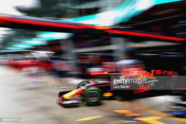 Max Verstappen of the Netherlands driving the Red Bull Racing Red BullTAG Heuer RB13 TAG Heuer leaves the garage during practice for the Malaysia...