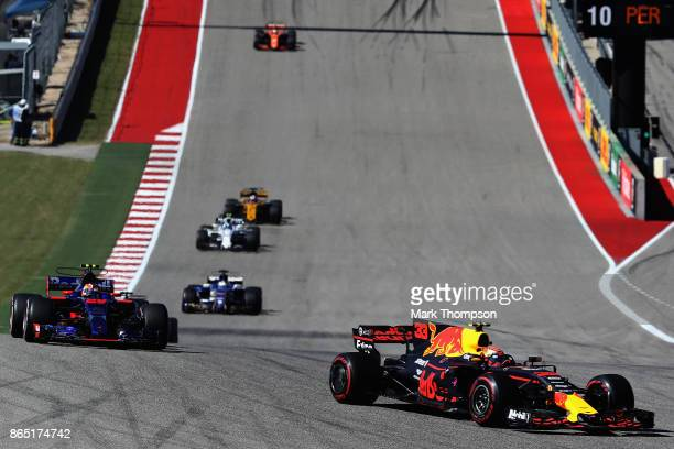 Max Verstappen of the Netherlands driving the Red Bull Racing Red BullTAG Heuer RB13 TAG Heuer leads Daniil Kvyat of Russia driving the Scuderia Toro...
