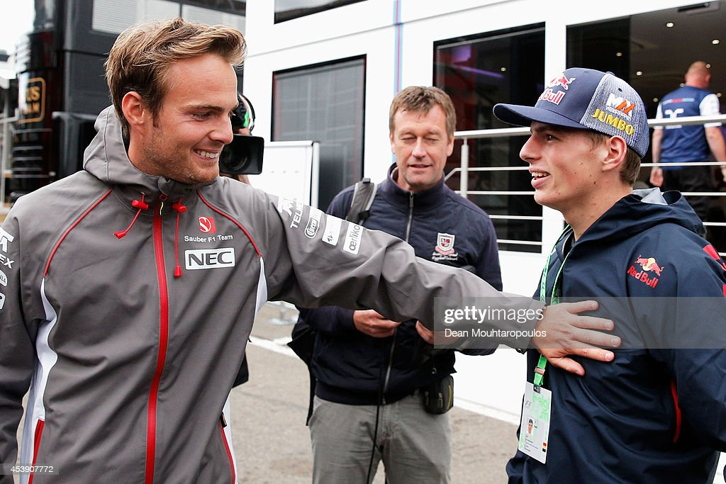 Max Verstappen who is set to replace JeanEric Vergne of France at Scuderia Toro Rosso next season speaks with test driver Giedo van der Garde of...