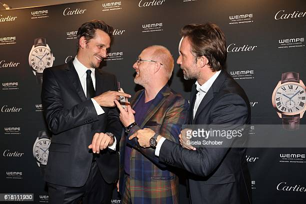 Max von Thun Simon Schwarz and Lucas Gregorowicz during the #Whatdrivesyou event by Cartier Wempe Weinstrasse on October 25 2016 in Munich Germany