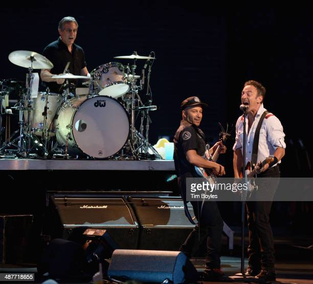 Max Weinberg Tom Morello and Bruce Springsteen and the E Street Band performs at MidFlorida Credit Union Amphitheatre on May 1 2014 in Tampa Florida