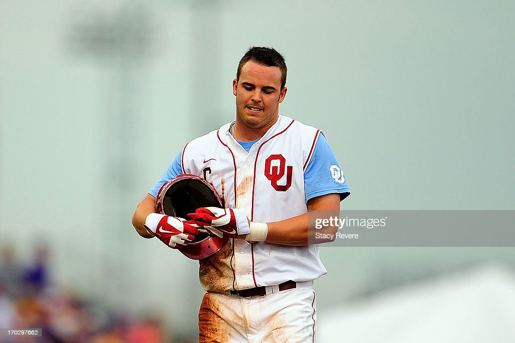 Max White #7 of the Oklahoma Sooners reacts to being called out at second base during Game 2 of the NCAA baseball Super Regionals against the LSU Tigers at Alex Box Stadium on June 8, 2013 in Baton Rouge, Louisiana.
