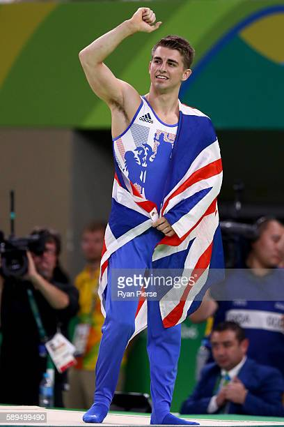 Max Whitlock of Great Britain celebrates winning the gold medal after the Men's Pommel Horse Final on Day 9 of the Rio 2016 Olympic Games at the Rio...