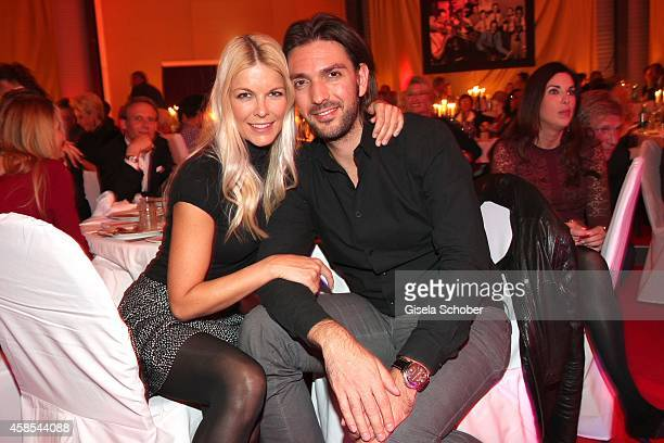 Max Wiedemann and his girlfriend Tina Kaiser attend the Cotton Club Dinnershow Premiere at Ungerer Bad on November 6 2014 in Munich Germany