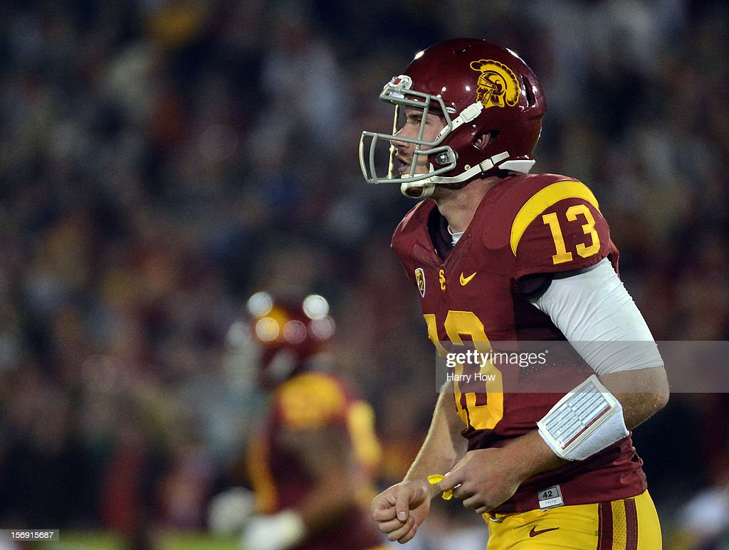 Max Wittek #13 of the USC Trojans leaves the field after his intercepted pass by KeiVarae Russell #6 of the Notre Dame Fighting Irish during the second quarter at Los Angeles Memorial Coliseum on November 24, 2012 in Los Angeles, California.