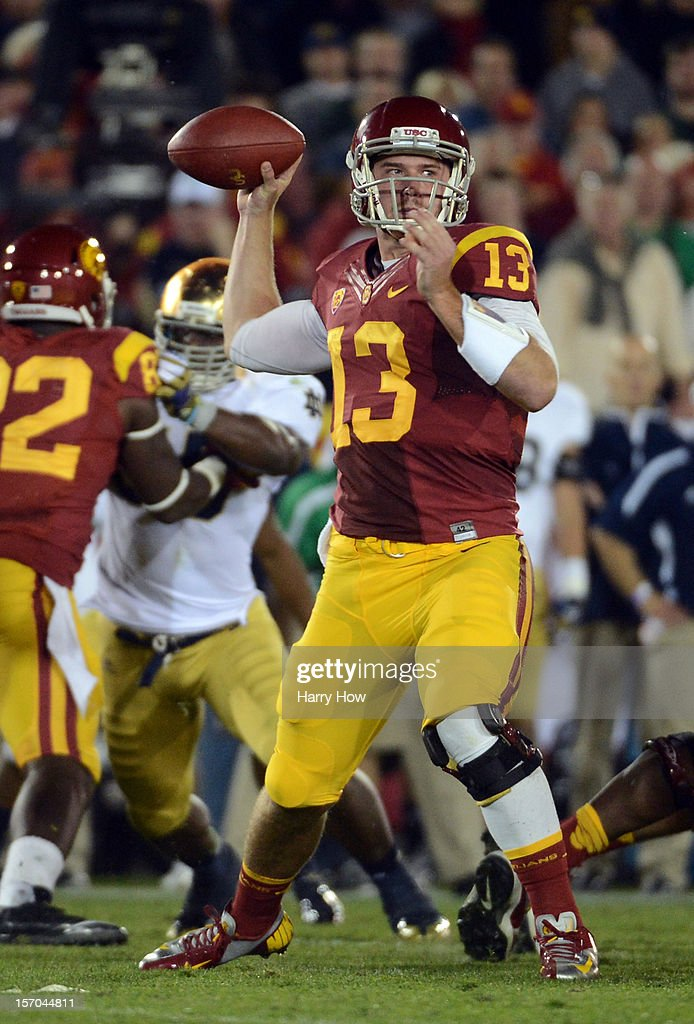 Max Wittek #13 of the USC Trojans passes during a 22-13 loss to the Notre Dame Fighting Irish at Los Angeles Memorial Coliseum on November 24, 2012 in Los Angeles, California.
