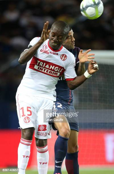 MaxAlain Gradel of Toulouse and Dani Alves aka Daniel Alves of PSG during the French Ligue 1 match between Paris Saint Germain and Toulouse FC at...