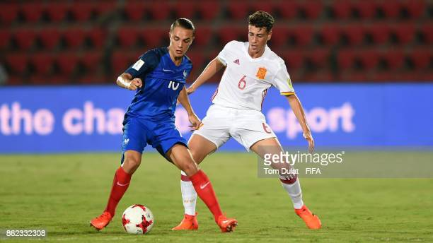 Maxence Caqueret of France and Antonio Blanco of Spain in action during the FIFA U17 World Cup India 2017 Round of 16 match between France and Spain...