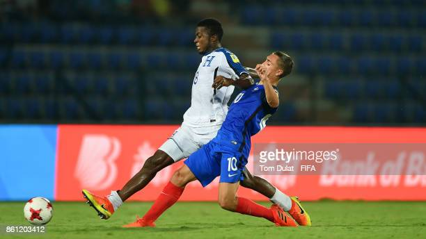 Maxence Caqueret of France and Gerson Chavez of Honduras in action during the FIFA U17 World Cup India 2017 group E match between France and Honduras...