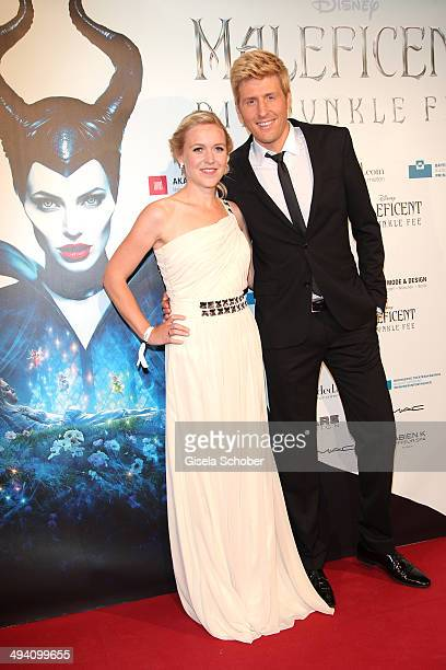 Maxi Arland and his wife Andrea Arland attend the Fashion Meets Movie gala screening of 'Maleficent' at Gloria Palast on May 27 2014 in Munich Germany