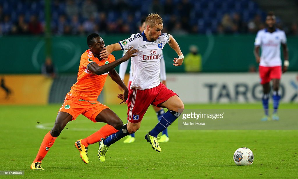 Maxi Beister (R) of Hamburg and Abdul Baba (L) of Greuther Fuerth battle for the ball during the DFB Cup second round match between Hamburger SV and Greuther Fuerth at Imtech Arena on September 24, 2013 in Hamburg, Germany.