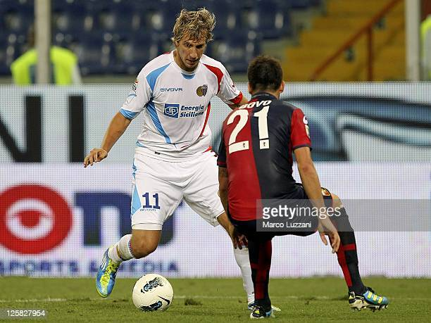 Maxi Lopez of Catania Calcio is challenged by Cesare Bovo of Genoa CFC during the Serie A match between Genoa CFC and Catania Calcio at Stadio Luigi...