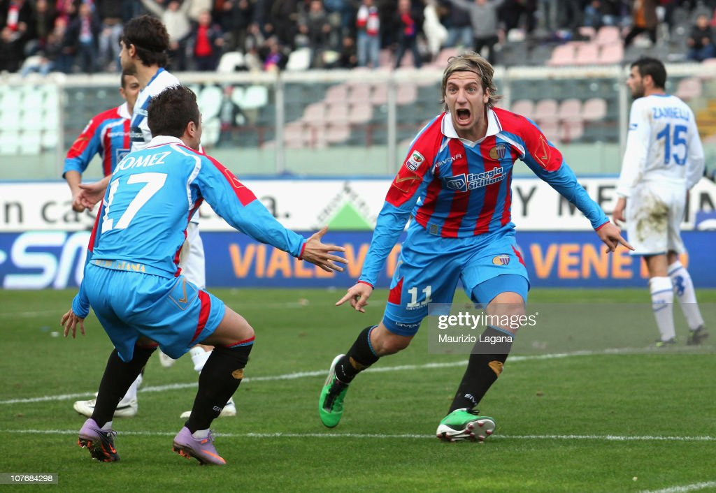 Maxi Lopez of Catania celebrates his opening goal with teammate Alejandro Gomez during the Serie A match between Catania and Brescia at Stadio Angelo...