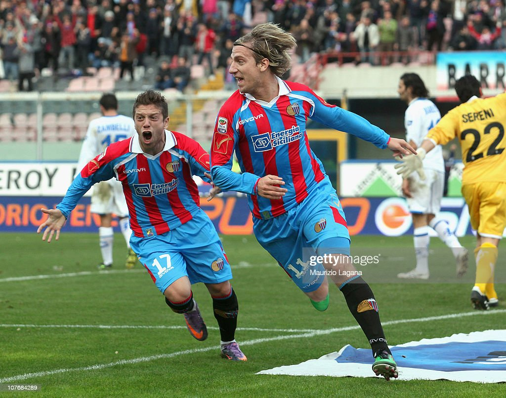Maxi Lopez of Catania celebrates with teammate Alejandro Gomez afer scoring the opening goal of the Serie A match between Catania and Brescia at...