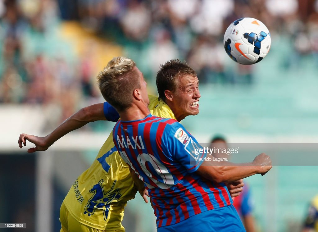 Maxi Lopez of Catania competes for the ball with Alessandro Bernardini of Chievo during the Serie A match between Calcio Catania and AC Chievo Verona...