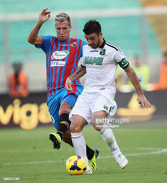 Maxi Lopez of Catania competes for the ball with Francesco Magnanelli of Sassuolo during the Serie A match between Calcio Catania and US Sassuolo...