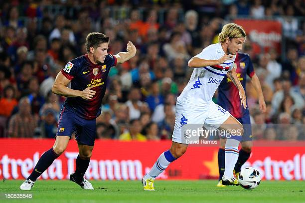 Maxi Lopez of Sampdoria duels for the ball with Andreu Fontas of FC Barcelona during the Joan Gamper Trophy friendly match between FC Barcelona and...