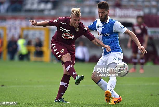 Maxi Lopez of Torino FC in action against Bostjan Cesar of AC Chievo Verona during the Serie A match between Torino FC and AC Chievo Verona at Stadio...