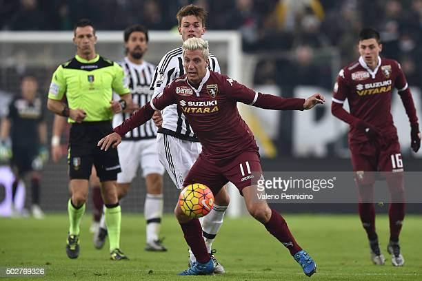 Maxi Lopez of Torino FC in action against Daniele Rugani of FC Juventus during the TIM Cup match between FC Juventus and Torino FC at Juventus Arena...