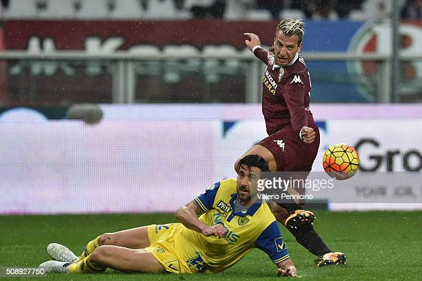 Maxi Lopez of Torino FC in action against Nicolas Federico Spolli of AC Chievo Verona during the Serie A match between Torino FC and AC Chievo Verona...