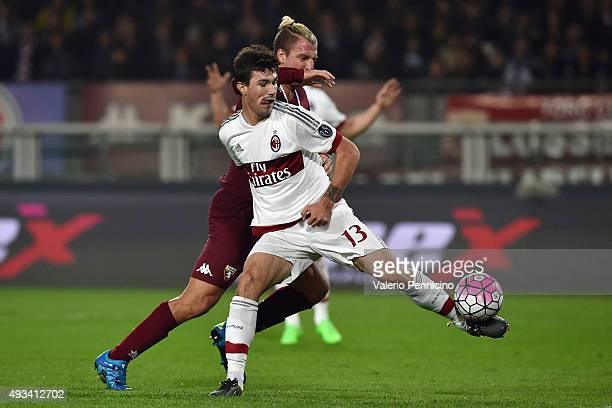 Maxi Lopez of Torino FC is challenged by Alessio Romagnoli of AC Milan during the Serie A match between Torino FC and AC Milan at Stadio Olimpico di...