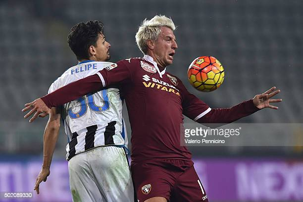 Maxi Lopez of Torino FC is challenged by Felipe of Udinese Calcio during the Serie A match between Torino FC and Udinese Calcio at Stadio Olimpico di...