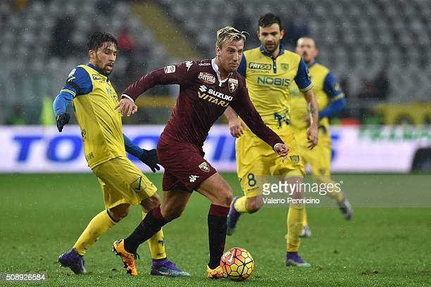 Maxi Lopez of Torino FC is challenged by Lucas Nahuel Castro of AC Chievo Verona during the Serie A match between Torino FC and AC Chievo Verona at...