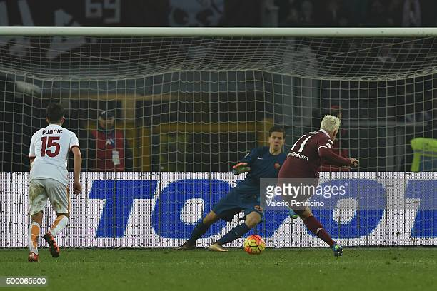 Maxi Lopez of Torino FC scores the equalising goal from the penalty spot during the Serie A match between Torino FC and AS Roma at Stadio Olimpico di...