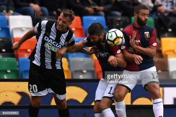 Maxi Lopez of Udinese and Luca Rossettini and Davide Biraschi of Genoa compete for a header during the Serie A match between Udinese Calcio and Genoa...
