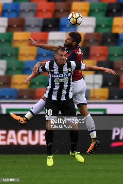 Maxi Lopez of Udinese and Luca Rossettini of Genoa compete for a header during the Serie A match between Udinese Calcio and Genoa CFC at Stadio...