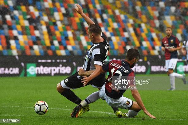 Maxi lopez of Udinese and Luca Rossettini of Genoa compete for the ball during the Serie A match between Udinese Calcio and Genoa CFC at Stadio...