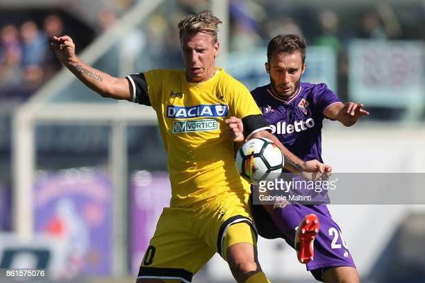 Maxi Lopez of Udinese Calcio against German Pezzella of ACF Fiorentina during the Serie A match between ACF Fiorentina and Udinese Calcio at Stadio...