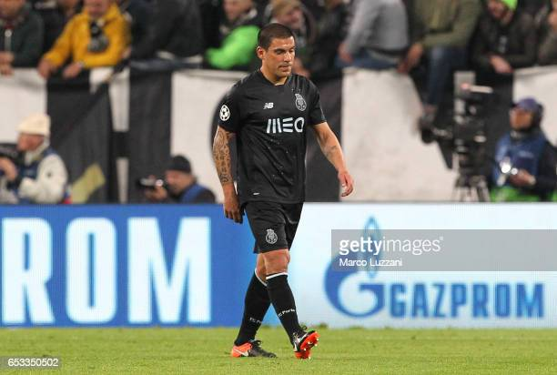 Maxi Pereira of FC Porto walks off after getting a red card the UEFA Champions League Round of 16 second leg match between Juventus and FC Porto at...