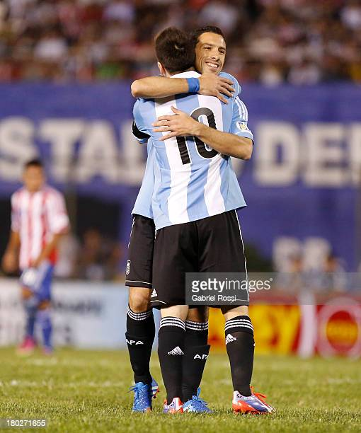 Maxi Rodriguez and Lionel Messi celebrate after Maxi Rodriguez scored the fifth goal during a match between Paraguay and Argentina as part of the...