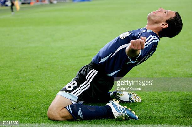 Maxi Rodriguez of Argentina celebrates scoring a goal by sliding on his knees during the FIFA World Cup Germany 2006 Group C match between Argentina...