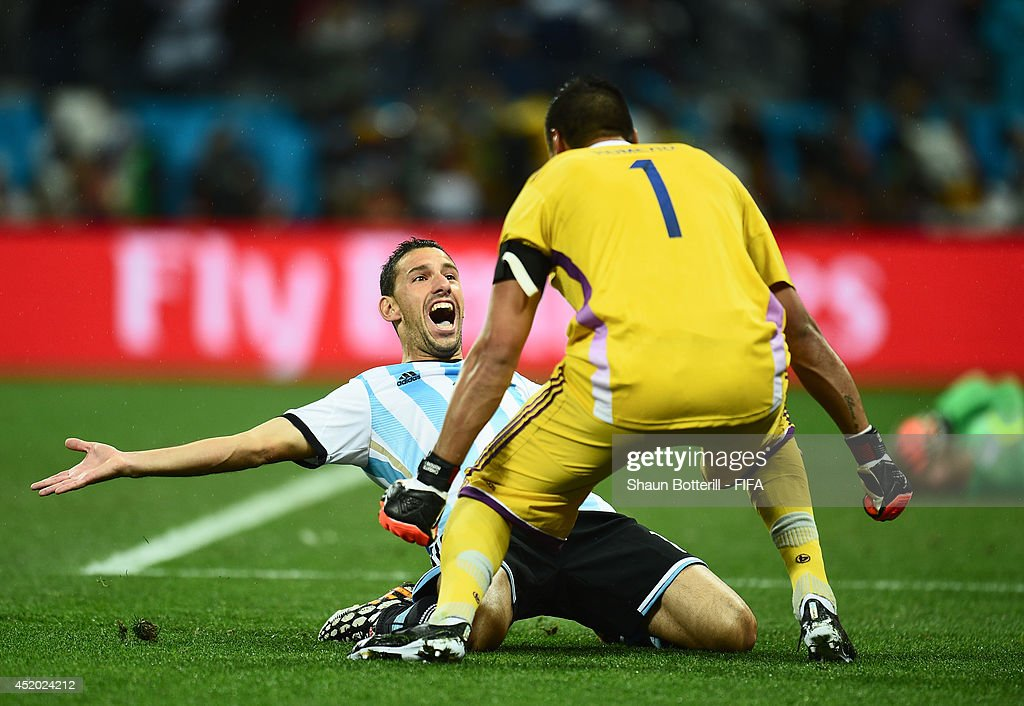 Maxi Rodriguez of Argentina celebrates with Sergio Romero after scoring the winning penalty in a shootout during the 2014 FIFA World Cup Brazil Semi Final match between Netherlands and Argentina at Arena de Sao Paulo on July 9, 2014 in Sao Paulo, Brazil.