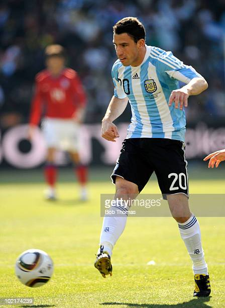 Maxi Rodriguez of Argentina handles the ball during the 2010 FIFA World Cup South Africa Group B match between Argentina and South Korea at Soccer...